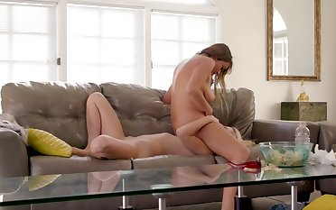 Classy MILF makes lesbian love on couch in the matter of bimbo stepdaughter