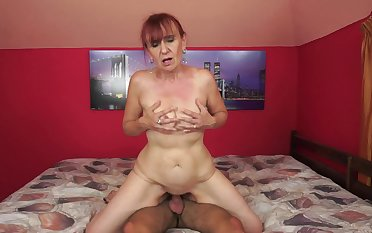 Granny takes care be incumbent on a young cock with her old skilled mouth