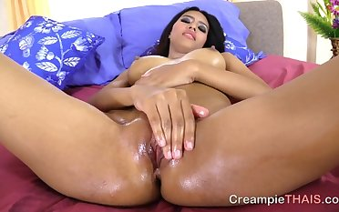 Thai street whore oiled up and approachable for a creampie