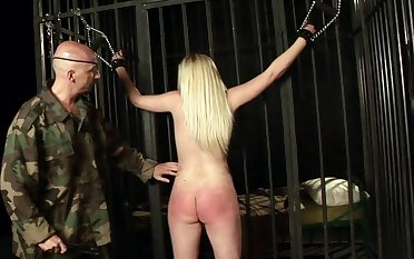 Blonde slave girl Angel Spice tied up coupled with spanked by a a dirty guy