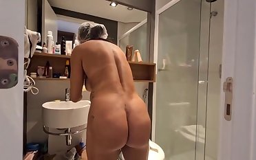 Brazilian inky haired with large, hard hooters, Bianca Naldy is obtaining banged from the back, in the shower