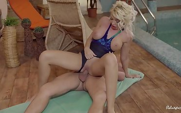 Busty Romanian blonde Ava Campos takes a hot erotic poolside nailing