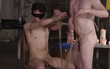 BDSM fetish video with a blindfolded gay dude being pleasured