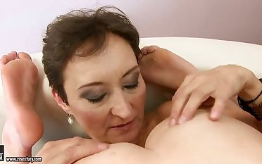 Marica is licking her girlfriends hairy pussy