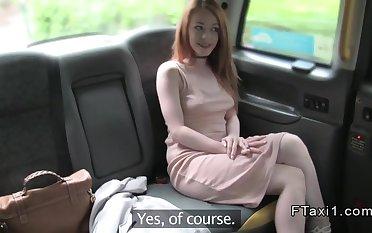 Petite redhead banged till facial in fake cab