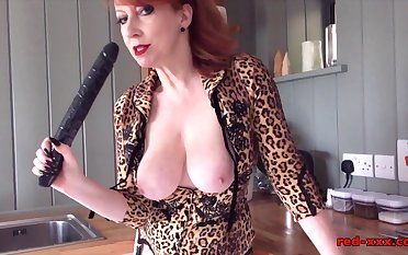 Mature Red XXX fucks a big black dildo