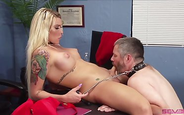 Spreading legs wide Tgirl Aubrey Kate makes submissive dude suck her dick
